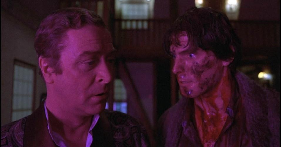 """Michael Caine e Christopher Reeve em cena do filme """"Armadilha Mortal"""" (1982)"""