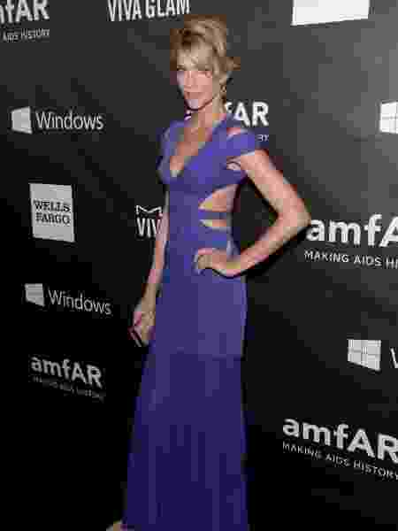 29.out.2014 - Tricia Helfer prestigia o baile de gala da amfAR no Milk Studios, em Los Angeles - Jason Kempin/Getty Images/AFP