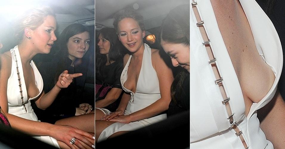 """10.nov.2014 - Jennifer Lawrence tem problema com vestido e deixa parte dos seios à mostra ao deixar a festa do filme """"Jogos Vorazes"""" com a cantora Lorde, em Londres"""