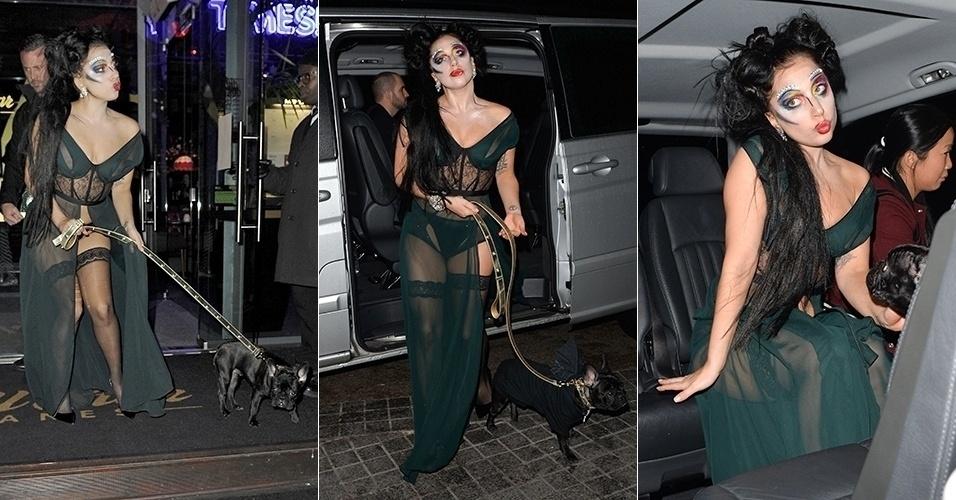 17.nov.2014 - Lady Gaga adicionou um novo look à sua galeria de visuais bizarros. Acompanhada de um cachorro, a cantora apareceu em Manchester, na Inglaterra, usando um vestido com transparências e uma grande fenda, meias 7/8 e uma maquiagem bem colorida e pesada em torno de seus olhos