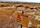 Turistas se aventuram entre campos minados para realizar ritual cristão - Marcel Vincenti/UOL