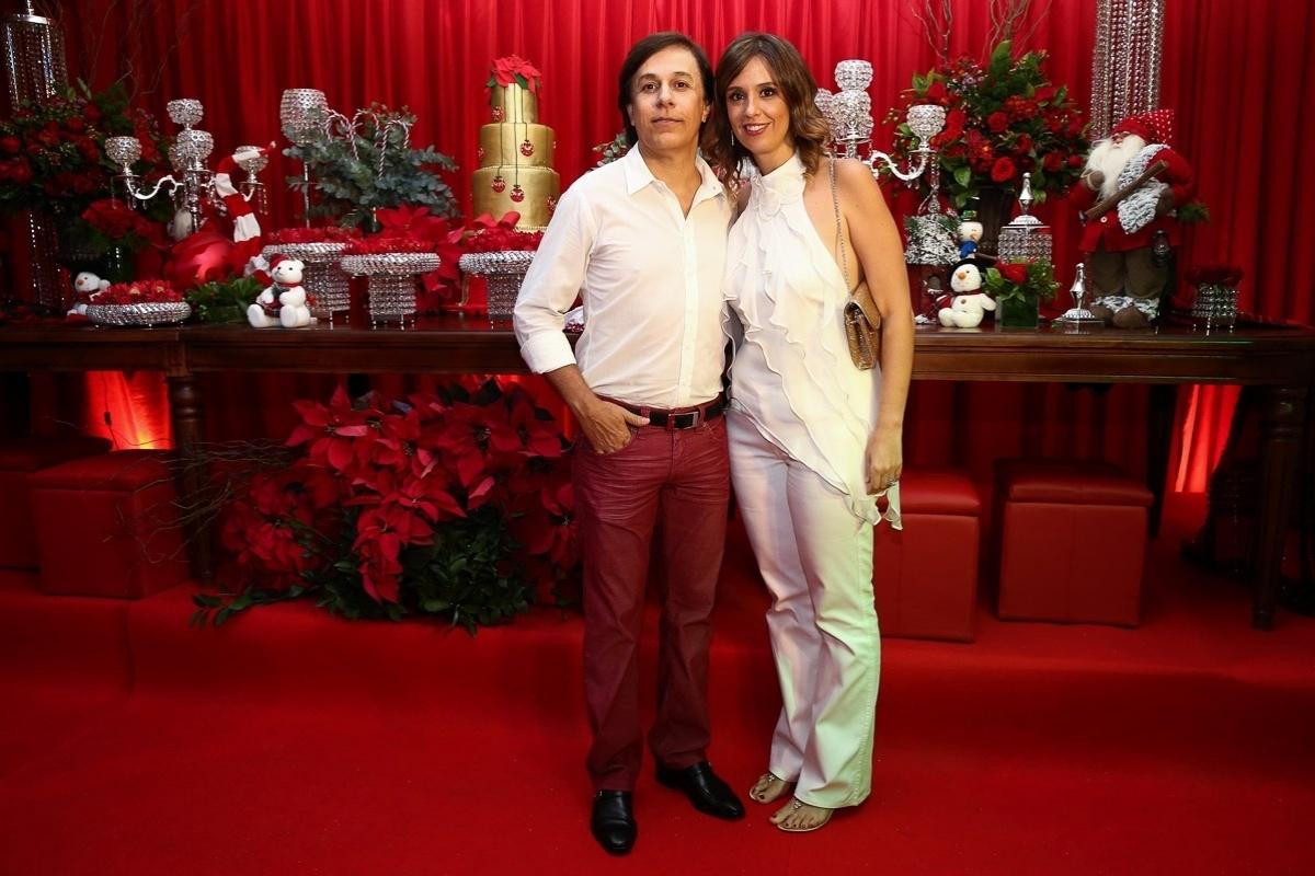 11.dez.2014 - Tom Cavalcante e a mulher, Patricia Lamounier, na festa antecipada de Natal da decoradora Andréa Guimarães, que aconteceu na noite dessa quinta-feira em um buffet, em São Paulo