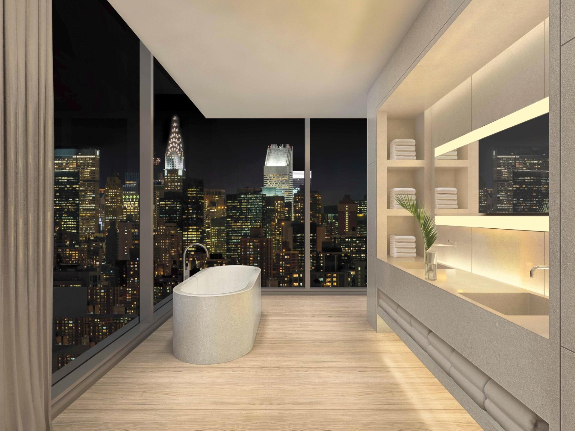 No projeto para o edifício na altura do número 215 da rua Chrystie, a cobertura prevê amplas aberturas no banheiro. Da gostosa banheira, posicionada junto à quina das janelas, será possível observar o horizonte de prédios de Nova York, com destaque para o Chrysler Building (à esq.) - Imagem do NYT, usar apenas no respectivo material