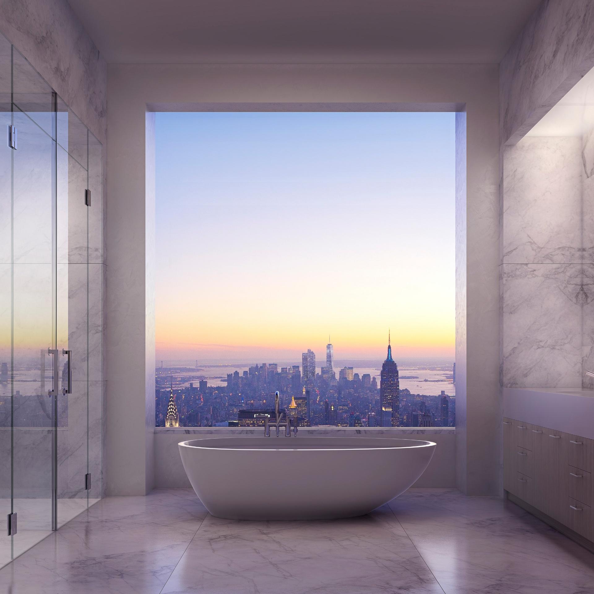 Em Manhattan, o prédio que será erguido no número 432, da Park Avenue, terá uma cobertura com vista panorâmica. O que chama a atenção no projeto é que o banheiro, revestido por mármore e de dimensões impactantes, terá uma banheira posicionada em frente a um pano de vidro - Imagem do NYT, usar apenas no respectivo material