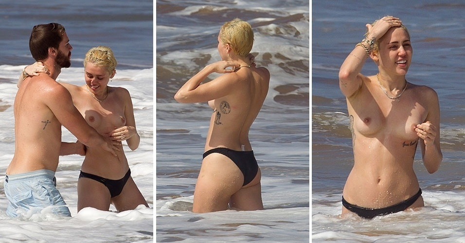 22.jan.2015 - A cantora Miley Cyrus faz topless enquanto se diverte com o namorado, Patrick Schwarzenegger, filho de Arnold, em praia no Havaí