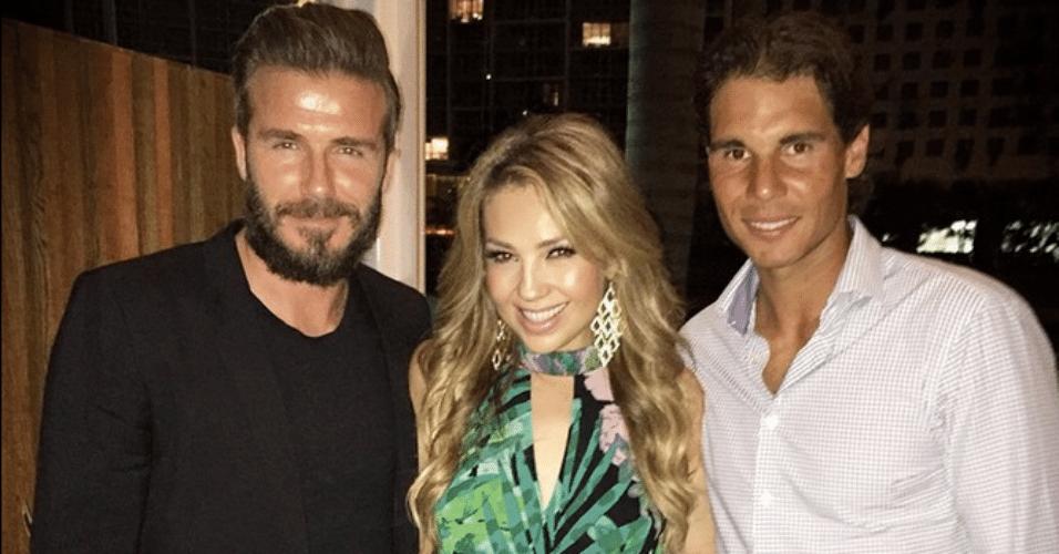23.mar.2015 - Thalia encontra o ex-jogador de futebol David Beckham e o tenista Rafael Nadal em evento em Miami, nos Estados Unidos, e tieta os esportistas