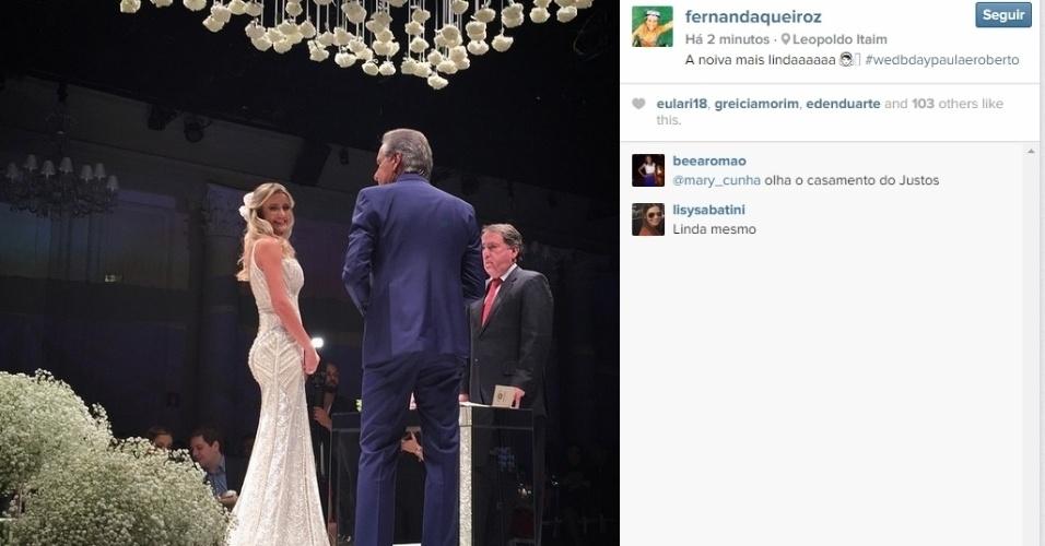 30.abr.2015 - Convidada para o casamento de Roberto Justus e Ana Paula Siebert, que acontece na noite desta quinta-feira, Fernanda Queiroz, publicou uma foto dos noivos durante a cerimônia.