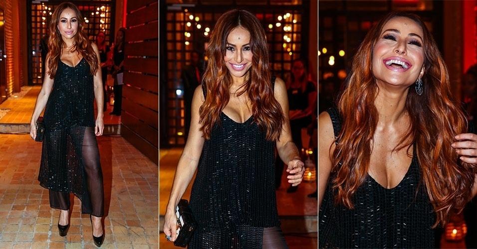 12.jun.2015 - Solteira, Sabrina vai a casamento de apresentadores dos produtores da Record Thaís e Bruno sozinha e exibe seus cabelos ruivos pela primeira vez