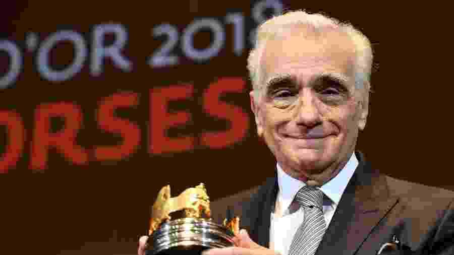 "O diretor Martin Scorsese recebe a ""Carruagem de Ouro"" no Festival de Cannes 2018 - AFP/YANN COATSALIOU"