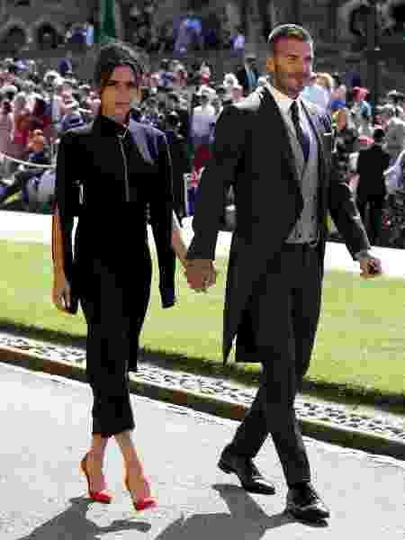 Victoria Beckham acompanhada do marido, David, no casamento real em 19 de maio - Getty Images