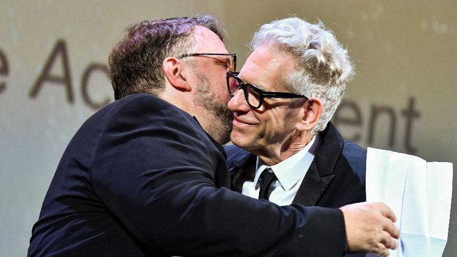 Guillermo del Toro entrega prêmio a David Cronenberg no Festival de Veneza - AFP/ALBERTO PIZZOLI