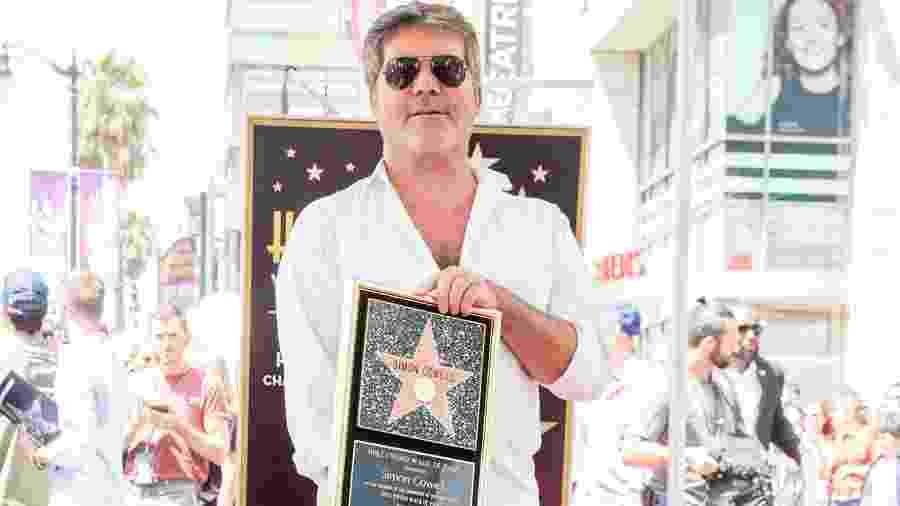 Simon Cowell ganha estrela na Calçada da Fama, em Hollywood - Rich Fury/Getty Images/AFP