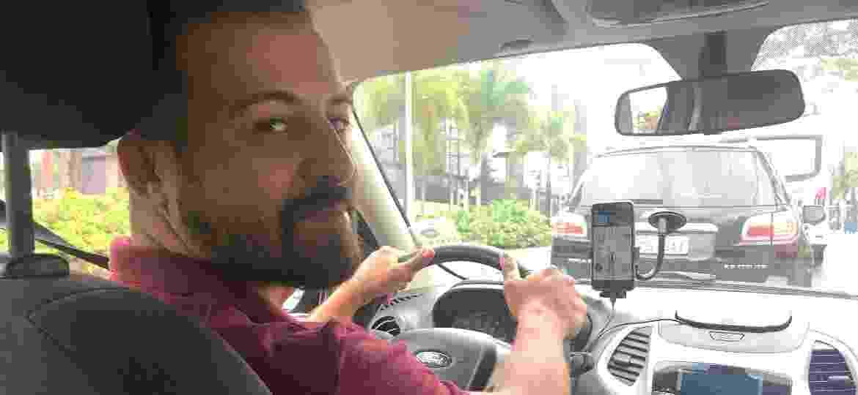 O motorista de Uber Danilo viu a quantidade de passageiros despencar e está penando para pagar o aluguel do carro, mesmo com desconto; muitos estão devolvendo o veículo - Alessandro Reis/UOL