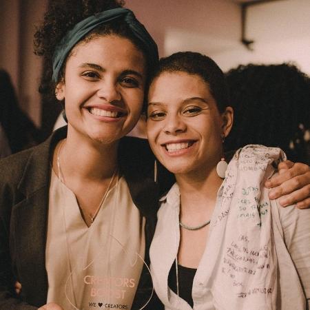 Gabriella Safe [direita] e Geórgia Barbosa [esquerda] são sócias no projeto Afroricas  - Reprodução/Instagram @afroricas