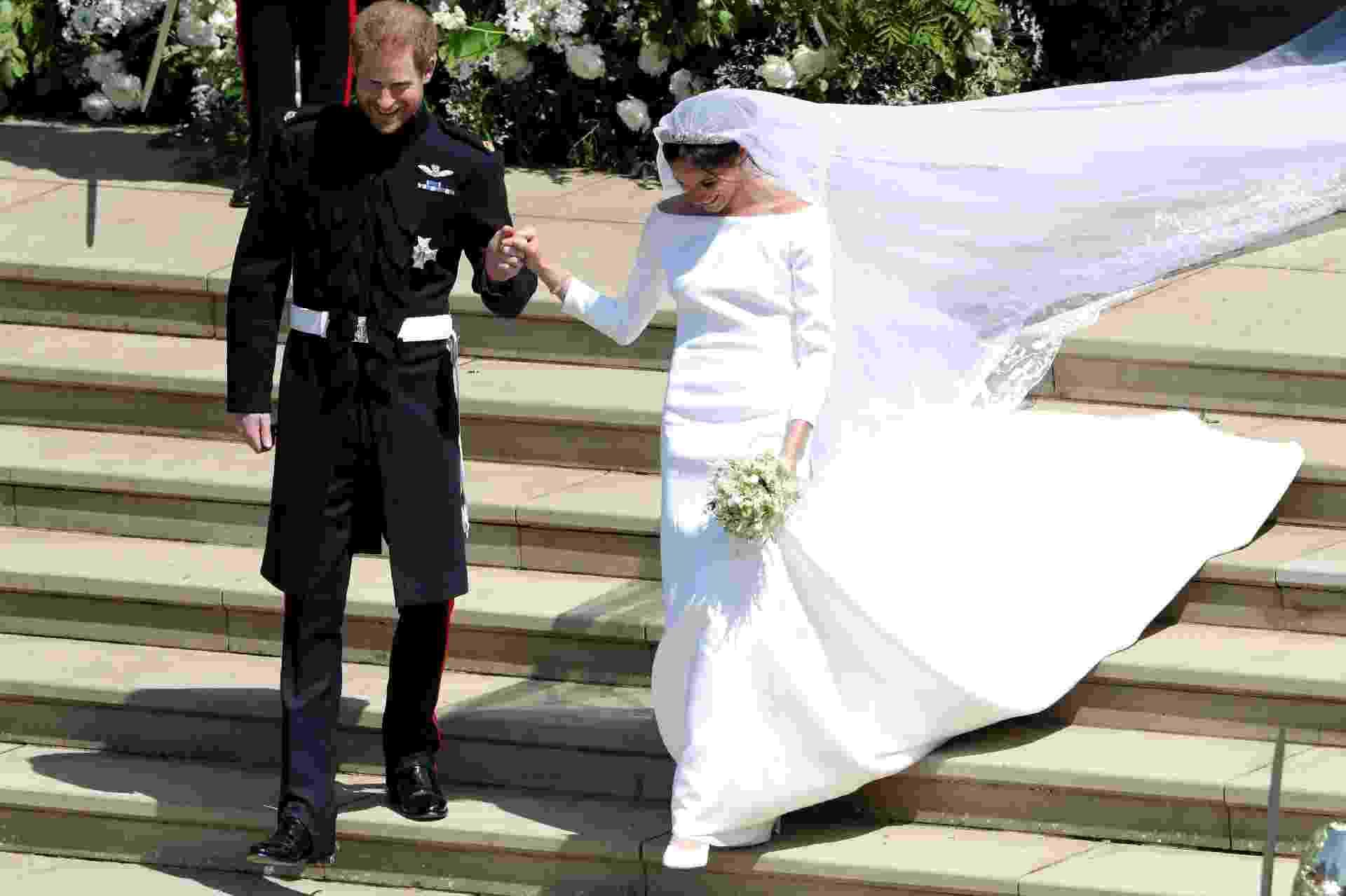 Harry e Meghan saem da igreja - Andrew Matthews/Reuters