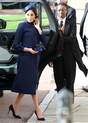 Meghan, a duquesa de Sussex, na chegada à cerimônia do casamento da princesa Eugenie