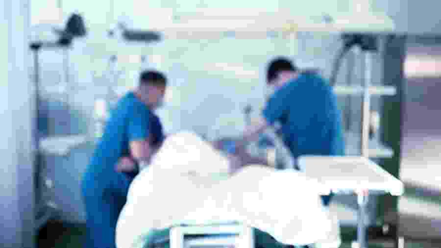 Americana com coronavírus deu à luz mesmo sedada - iStock