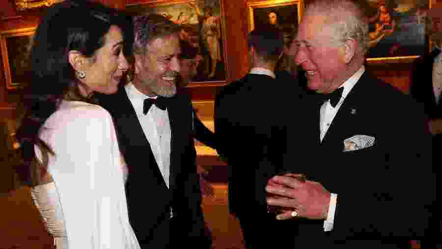 Amal Clooney, George Clooney e o príncipe Charles - Getty Images