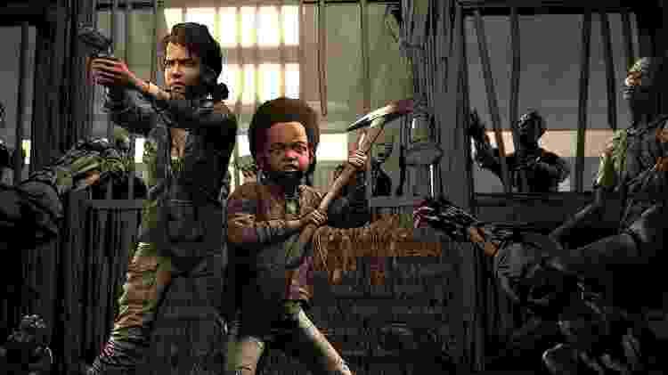 Clementine e AJ em uma das cenas finais de 'The Walking Dead' - Reprodução - Reprodução