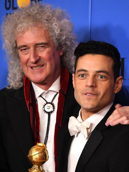 Brian May, guitarrista do Queen, posa com o ator Rami Malek - Mark Ralston/AFP