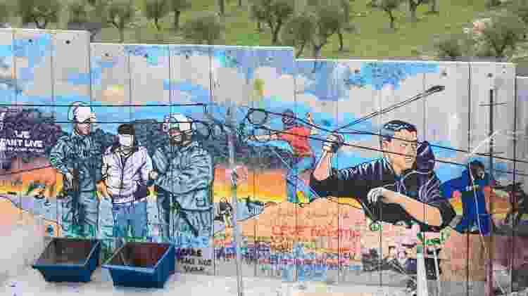 Muro que separa Israel da Cisjordânia é coberto por grafites de protesto - Getty Images - Getty Images