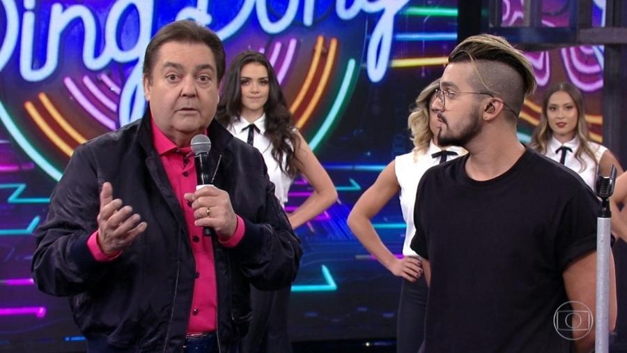 O apresentador Fausto Silva recebe Luan Santana em seu programa e critica a intervenção militar no Rio de Janeiro - Reprodução