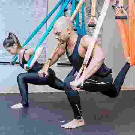No pilates em suspensão, você usa fitas de tecido para fazer os exercícios - Divulção/Voll Pilates Group