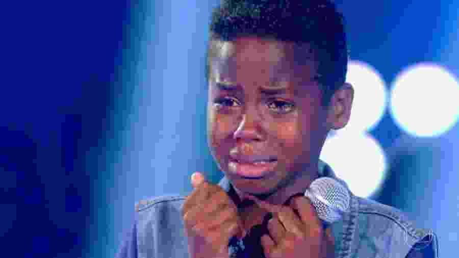 """Jeremias Reis se emociona no """"The Voice Kids"""" - Reprodução/Globo"""