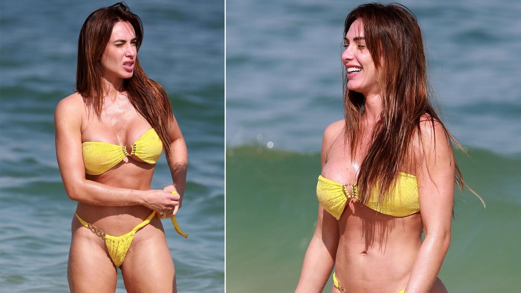 Nicole Bahls enfrenta mar gelado, faz careta, mas curte praia no Rio