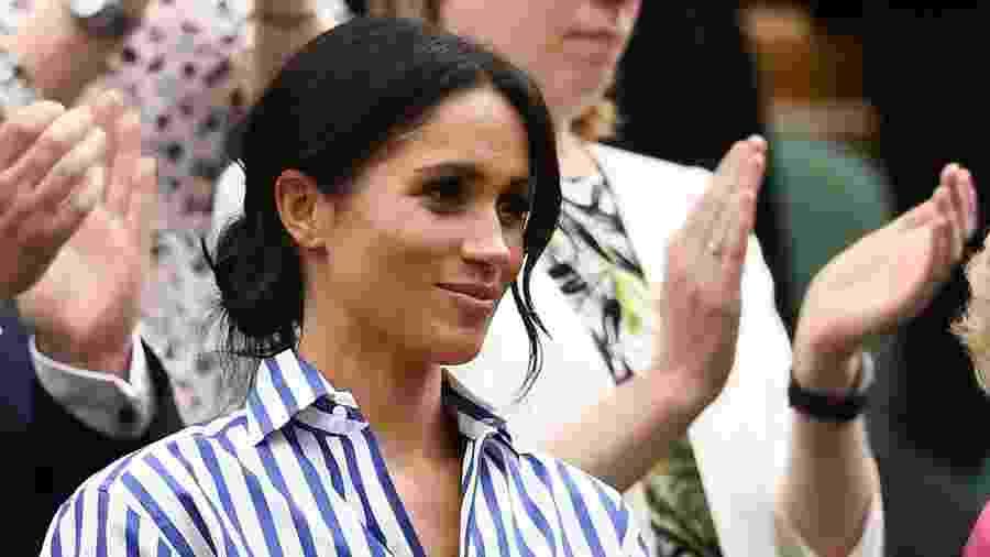 No sábado (14), Meghan esteve com Kate na final feminina individual do torneio de Wimbledon com calça e camisa Ralph Lauren - Getty Images