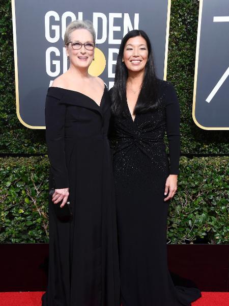 Meryl Streep com a representante das trabalhadoras domésticas, Ai-jen Poo - Getty Images