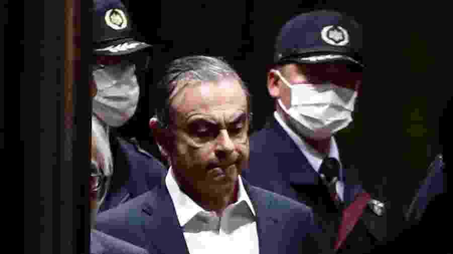 24.abr.2019 - Carlos Ghosn deixa casa de detenção em Tóquio após pagar fiança de R$ 17,8 milhões - Behrouz MEHRI/AFP