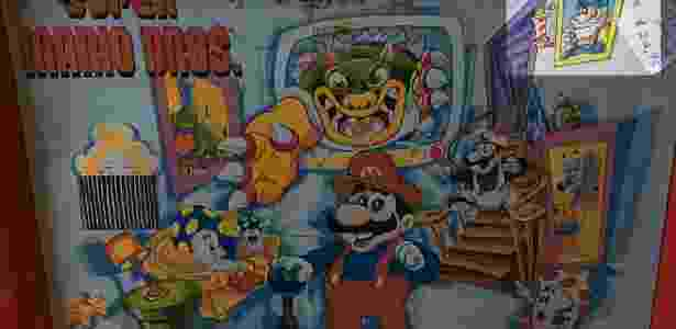 Quadro no canto da ilustração mostra personagem misterioso: até o momento, a Nintendo não se pronunciou sobre a questão - Reprodução