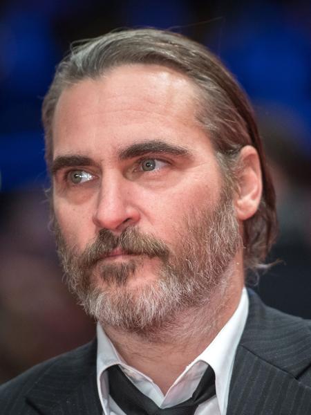 O ator Joaquin Phoenix é cotado para viver Coringa no cinema -  AFP/Stefanie LOOS