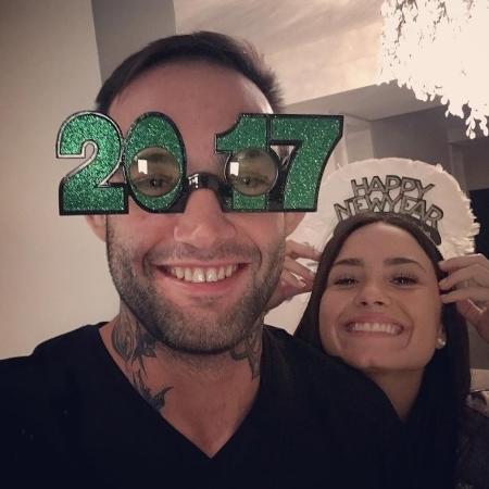 Atleta Guilherme Bomba com a cantora Demi Lovato - Reprodução/Instagram/bombatuf