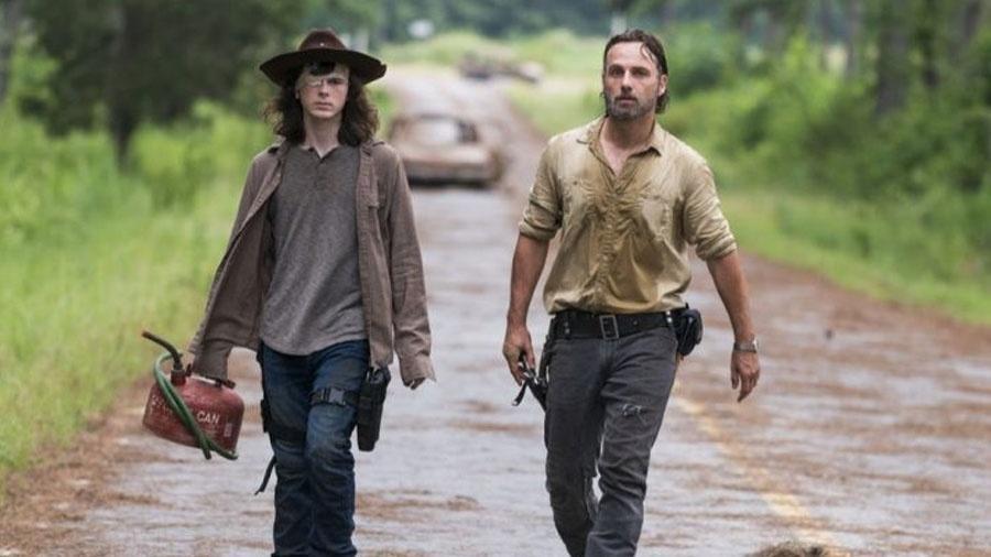 """Rick e Carl em cena de """"Walking Dead"""" - Divulgação/AMC"""