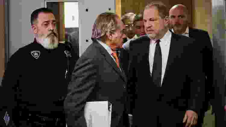 Harvey Weinstein deixa o tribunal ao lado de seu advogado Benjamin Brafman  - Spencer Platt/Getty Images/AFP - Spencer Platt/Getty Images/AFP