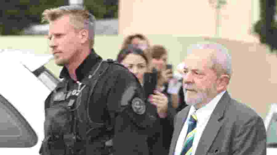 O agente federal Jorge Chastalo e o ex-presidente Lula - Theo Marques/UOL/Folhapress