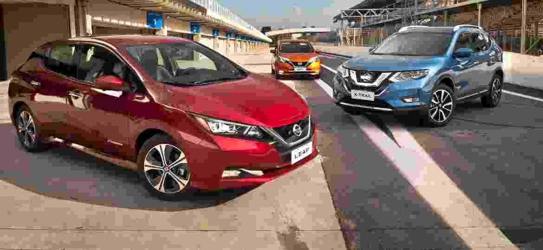 Nissan Leaf (vermelho) e X-Trail (azul) estão garantidos; Note (laranja) não vem, mas dá origem ao Kicks híbrido - Divulgação