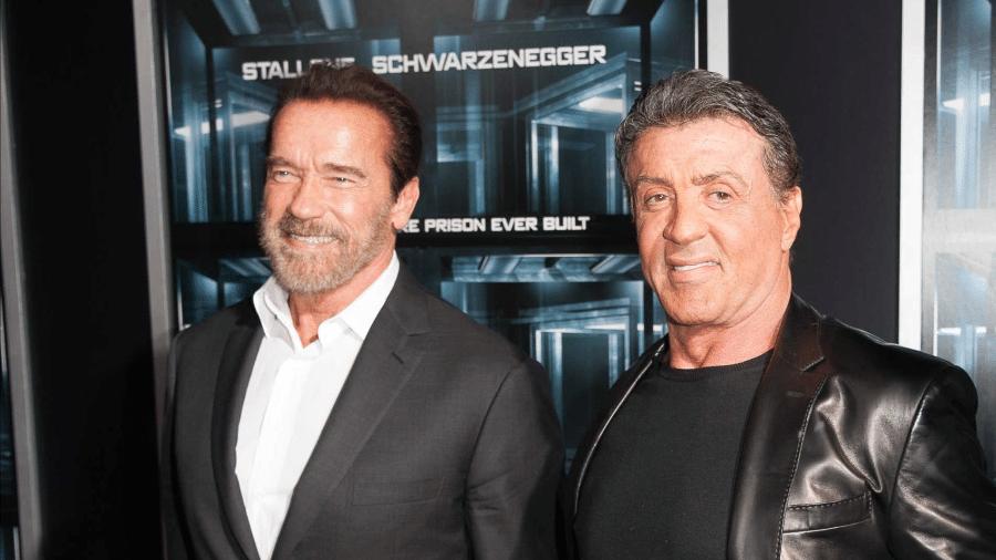 Os atores Sylvester Stallone e Arnold Schwarzenegger - Getty Images