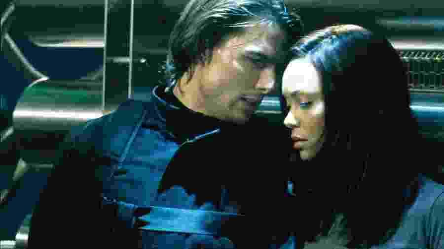 Thandie Newton e Tom Cruise em Missão Impossível 2 - Reprodução/IMDB