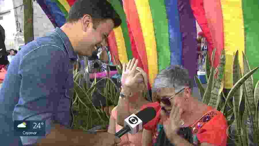 O repórter Marcelo Poli, da Globo, é paquerado na Parada LGBT - Reprodução/TV Globo