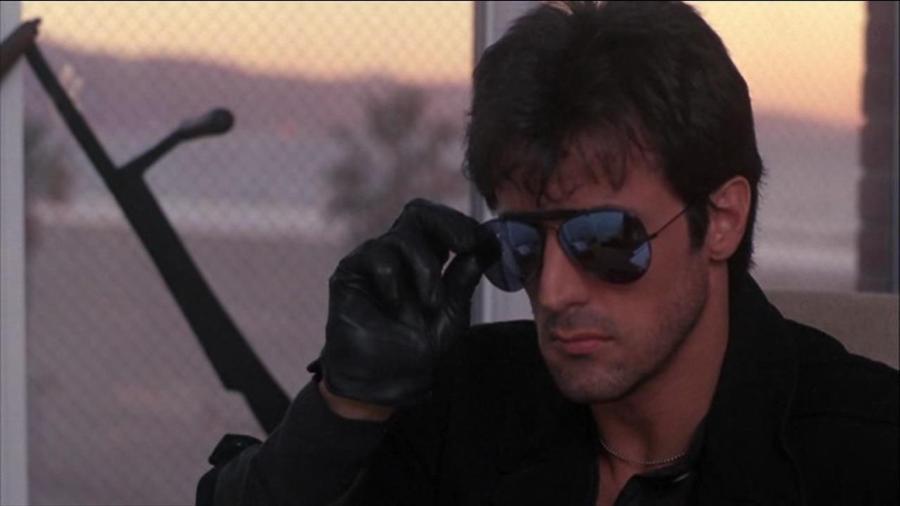 """Sylvester Stallone em cena de """"Stallone Cobra"""" (1986) - Reprodução"""