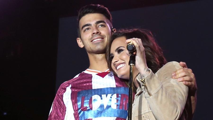 Joe Jonas e Demi Lovato em show da banda dele, DNCE, em novembro de 2016 - Getty Images