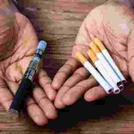 Há fraca evidência de que os cigarros eletrônicos podem ajudar pessoas a pararem de fumar ou que são mais seguros do que fumar - iStock