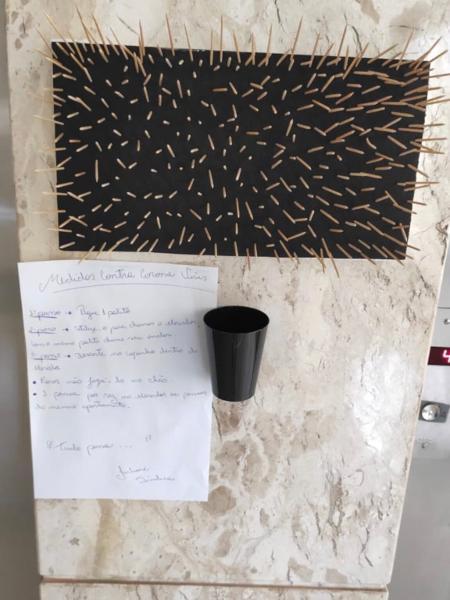 Palitinhos usados para evitar que moradores apertam botão do elevador - Reprodução/Twitter