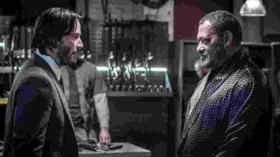 """John Wick (Keanu Reeves) e The Bowery King (Laurence Fishburne) em cena de """"John Wick 2"""" - Divulgação"""