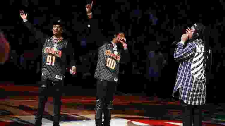 Quavo, Offset e Takeoff, do coletivo de rappers Migos, se apresentam no intervalo de um jogo de basquete em Atlanta - Brett Davis/USA TODAY Sports - Brett Davis/USA TODAY Sports