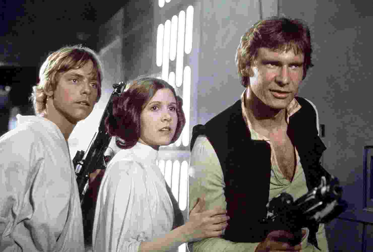 """Harrison Ford, Carrie Fisher e Mark Hamill em cena de """"Star Wars: Episódio IV - Uma Nova Esperança"""" (1977) - Divulgação"""