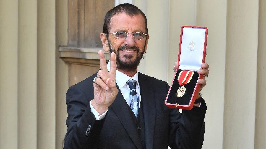 """Ringo Starr recebe o título de Cavaleiro da Excelentíssima Ordem do Império Britânico, popularmente conhecido como """"sir"""" - JOHN STILLWELL/AFP"""